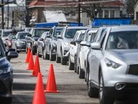 People in a long line of cars get ready for their second doses at Fair Park in Dallas County on Sunday, February 21, 2021.