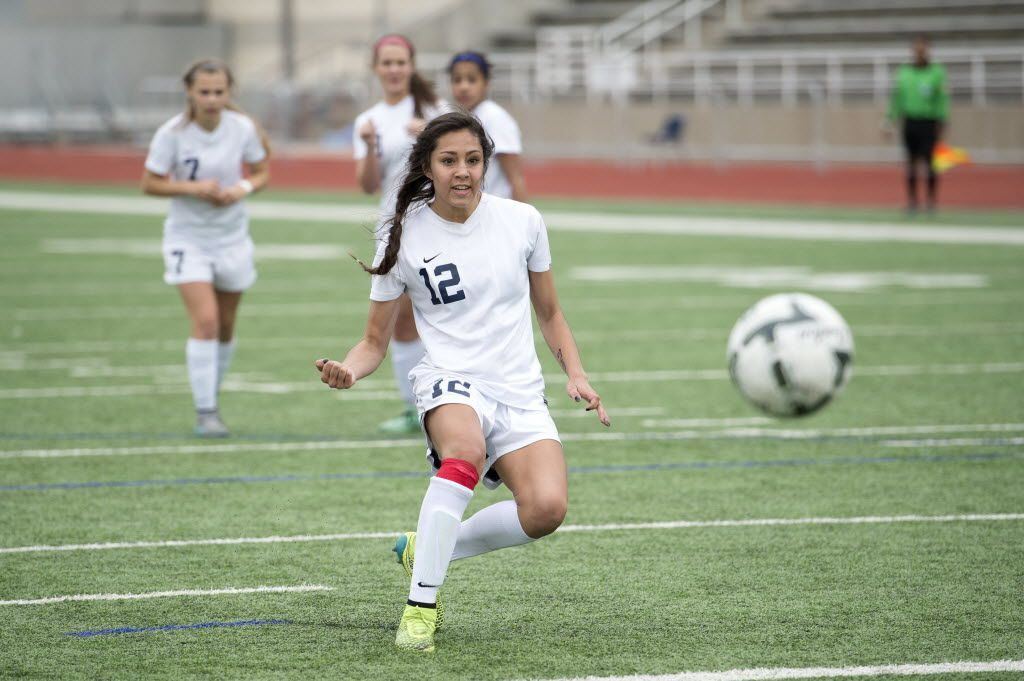 Frisco Centennial junior forward Katelyn Termini (12) watches her tie-breaking penalty kick sail into the net during the second half of their 2-0 win over Frisco in the UIL Class 5A Region II final girls soccer game on Saturday, April 9, 2016 at Standridge Stadium in Carrollton, Texas. (Jeffrey McWhorter/Special Contributor)