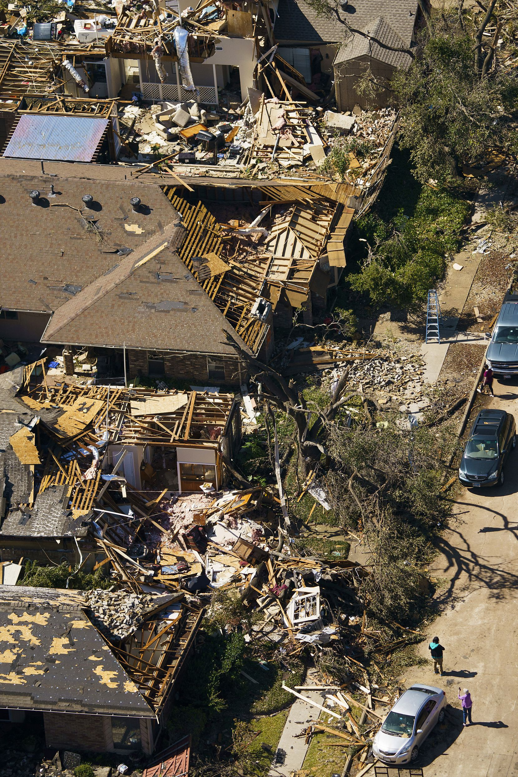 Damaged homes along Tall Oaks Drive on Monday, Oct. 21, 2019, in Richardson.