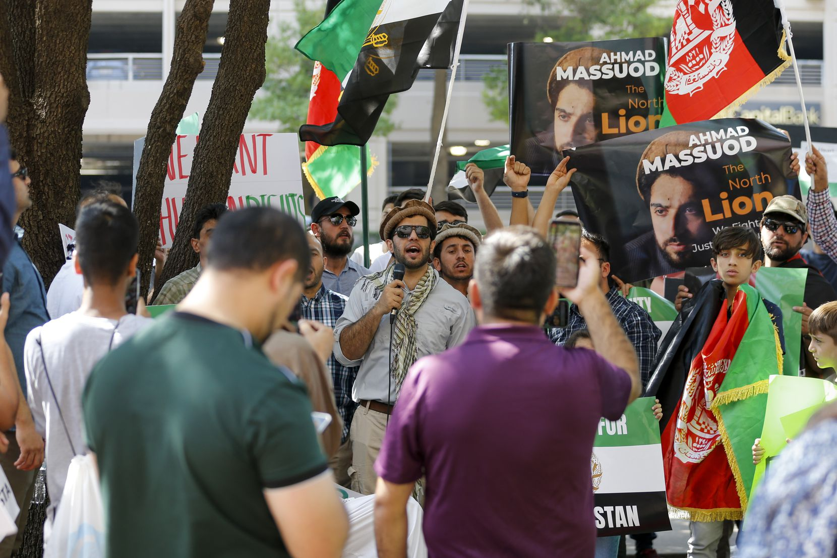Basir Noory speaks to protesters during a demonstration outside of Sen. John Cornyn's office on Tuesday, Sept. 7, 2021, in Dallas. Protesters rallied in support of the resistance movement to the Taliban takeover in Afghanistan.