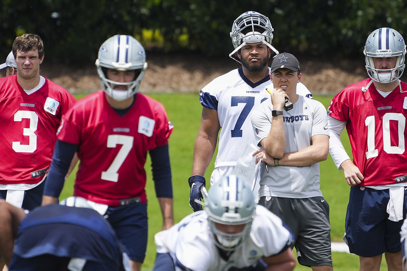 Dallas Cowboys offensive coordinator Kellen Moore watches quarterback Ben DiNucci (7) take a snap as fellow backup quarterbacks Garrett Gilbert (3) and Cooper Rush (10) look on during a minicamp practice at The Star on Tuesday, June 8, 2021, in Frisco. (Smiley N. Pool/The Dallas Morning News)