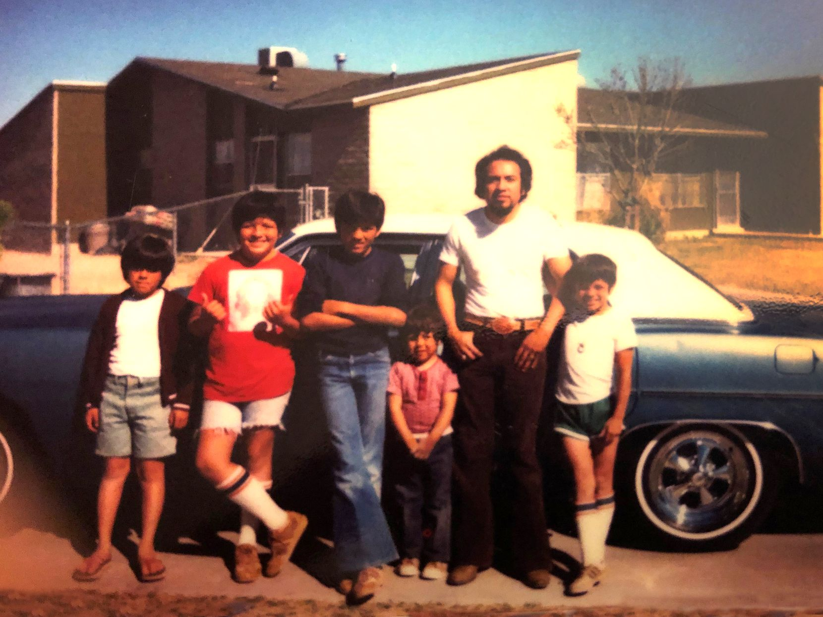 Fred Ortiz (in blue jeans) at 11, with his father, Aniceto, and four brothers in the Lyndon B. Johnson public housing complex of El Paso.