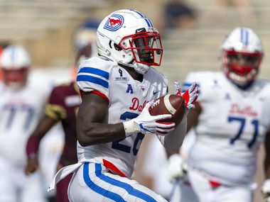 Southern Methodist running back Ulysses Bentley IV (26) scores a touchdown against Texas State during an NCAA football game on Saturday, Sept. 5, 2020 in San Marcos, Texas. (AP Photo/Stephen Spillman)