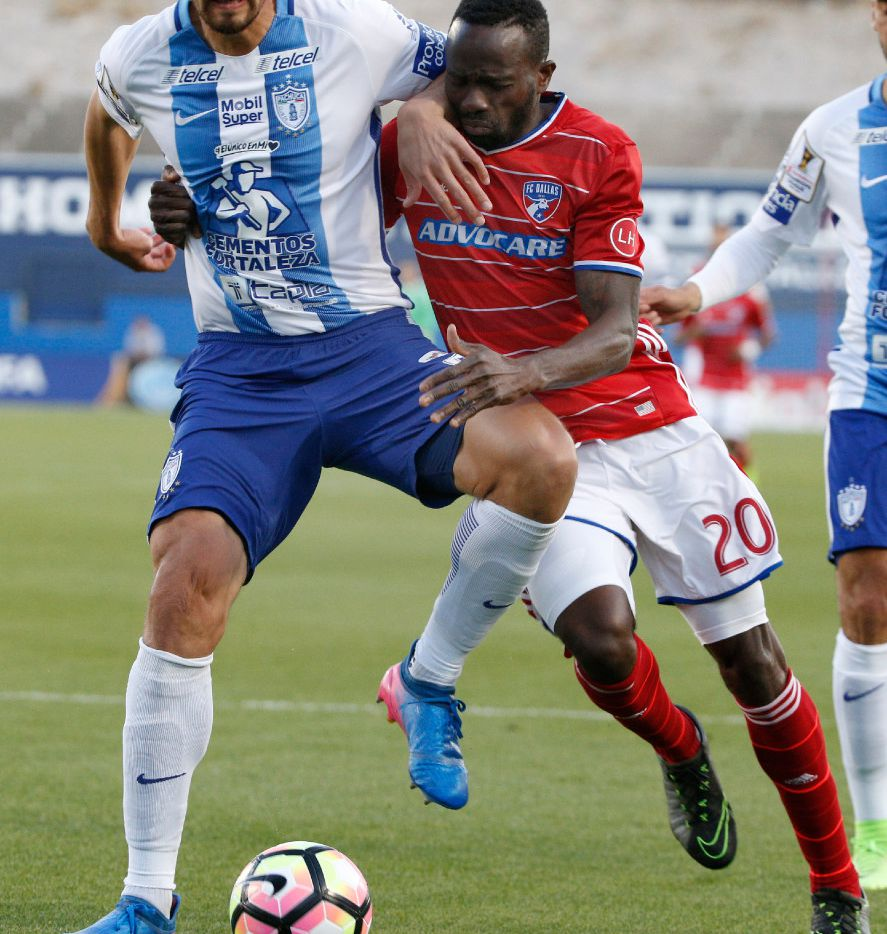 Pachuca defender Omar Gonzalez (4) and FC Dallas forward Roland Lamah (20) fight for possession during the CONCACAF Champions League semifinal at Toyota Stadium in Frisco, Texas on March 15, 2017. (Nathan Hunsinger/The Dallas Morning News)
