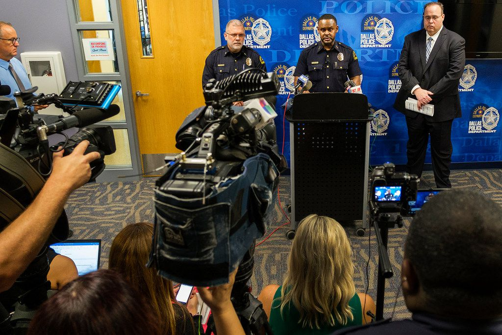 Dallas Police Deputy Chief Avery Moore addresses a press conference regarding overnight homicides on Friday, May 31, 2019, in Dallas. Beside him are Maj. Max Geron (left) and Lt. Lance Hunter.