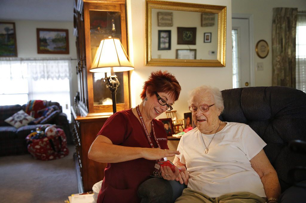 Encompass Home Health physical therapist Kelly Bailey shares her recipes with patient Lillie Patridge, 87, during a home care visit in Arlington.