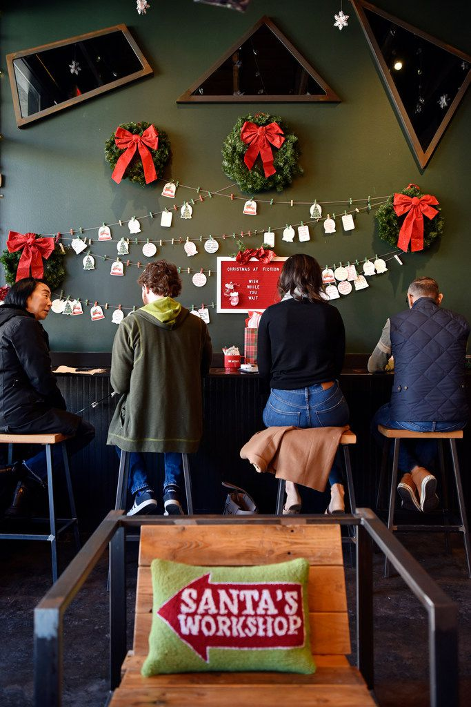 On one wall of Deck the Hall Street coffee shop, patrons can leave wishes for Santa.