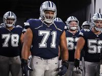 Dallas Cowboys offensive tackle La'el Collins (71) waits to take the field with offensive tackle Terence Steele (78), center Tyler Biadasz (63), guard Connor Williams (52) and offensive tackle Tyron Smith (77) before an NFL football game against the Tampa Bay Buccaneers at Raymond James Stadium on Thursday, Sept. 9, 2021, in Tampa, Fla.