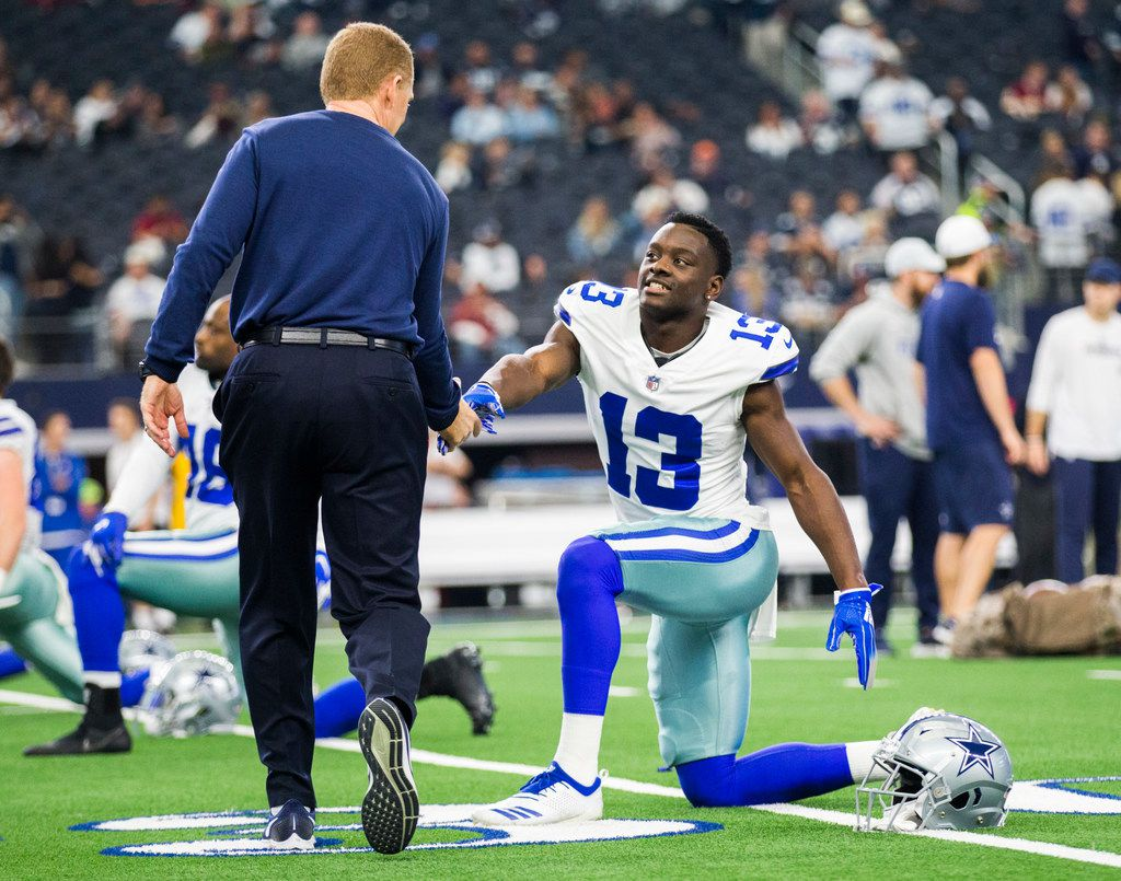 Dallas Cowboys wide receiver Michael Gallup (13) gets a handshake from head coach Jason Garrett before a Thanksgiving Day NFL football game between the Dallas Cowboys and the Washington Redskins on Thursday, November 22, 2018 at AT&T Stadium in Arlington, Texas. (Ashley Landis/The Dallas Morning News)