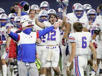 Austin Westlake head coach Todd Dodge prepares to hug quarterback Cade Klubnik (6) as time expires on their 52-34 victory over Southlake Carroll in the Class 6A Division I state championship game at AT&T Stadium on Saturday, Jan. 16, 2021, in Arlington, Texas.
