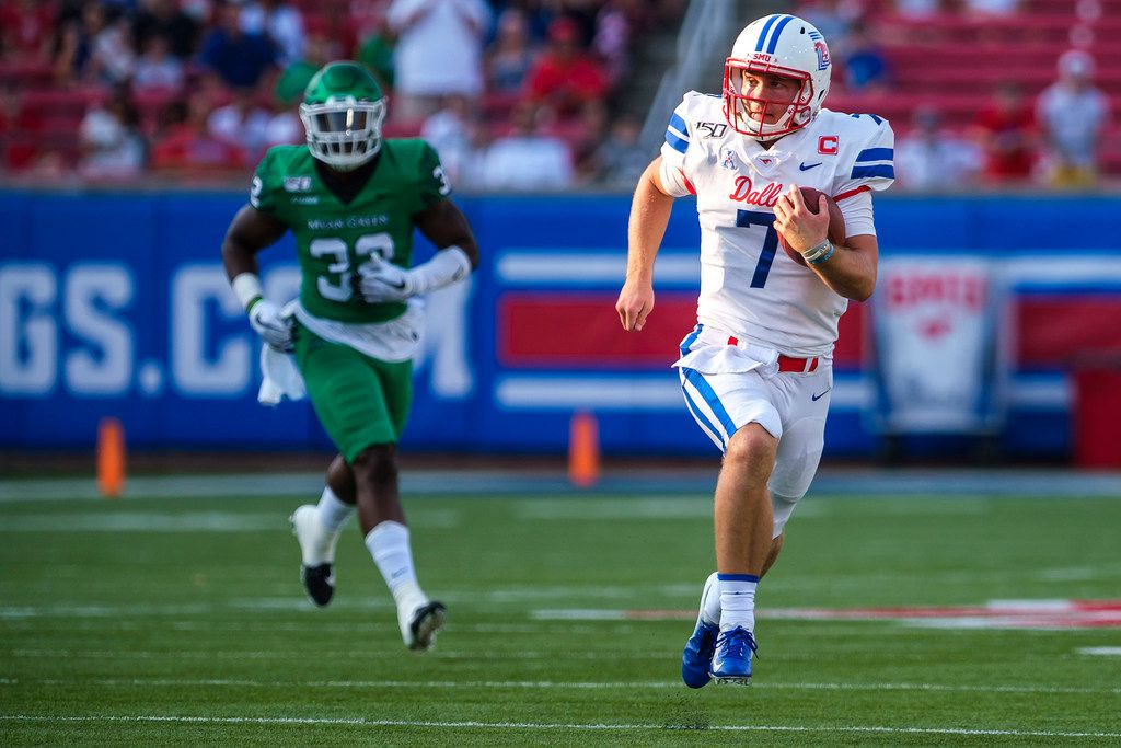 FILE - SMU quarterback Shane Buechele (7) runs for a first down against North Texas during the first half at Ford Stadium in Dallas on Saturday, Sept. 7, 2019. SMU won, 49-27.