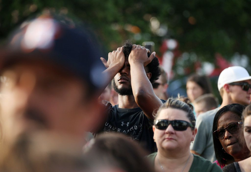 A mourner reacts during a vigil following a shooting at Santa Fe High School on May 18.