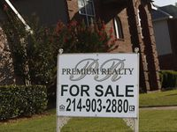 "A ""For Sale"" sign stands in front of a house on Trees Drive in Cedar Hill, Texas on Monday, August 10, 2020. Home sales in North Texas exploded in July, rising 25% from a year ago to the largest ever single-month sales total."