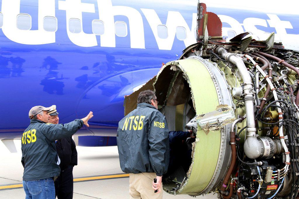 National Transportation Safety Board investigators examine damage to the CFM International 56-7B turbofan engine belonging Southwest Airlines Flight 1380 that separated during flight Philadelphia International Airport on April 17 in Philadelphia.