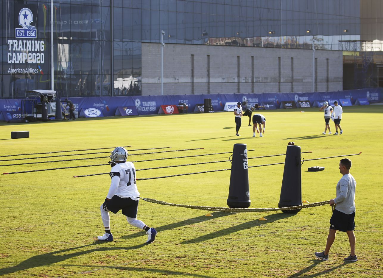 Dallas Cowboys offensive tackle La'el Collins (71) works with Dallas Cowboys trainer Britt Brown during the first day of training camp at Dallas Cowboys headquarters at The Star in Frisco, Texas on Friday, August 14, 2020.