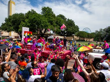Parade-goers attempt to catch souvenirs during the annual Dallas Pride / Alan Ross Texas Freedom Parade at Fair Park in Dallas on Sunday, June 2, 2019. (Shaban Athuman/Staff Photographer)