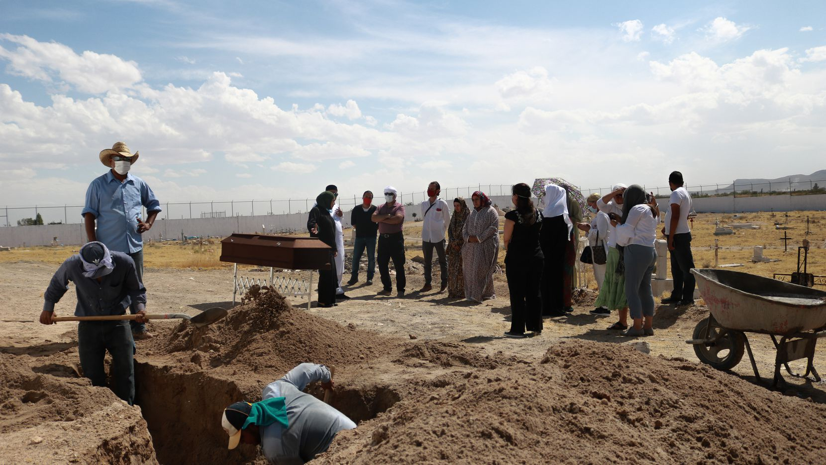 Cemetery workers dig a grave in a cemetery in Ciudad Juarez, Mexico, on June 11, 2020, to bury Jamila Nabunjo, a Muslim immigrant from Uganda, who lived in a shelter while waiting to petition for asylum in the United States. Nabunjo died in September of 2019 and it took months for the local authorities to release her body.