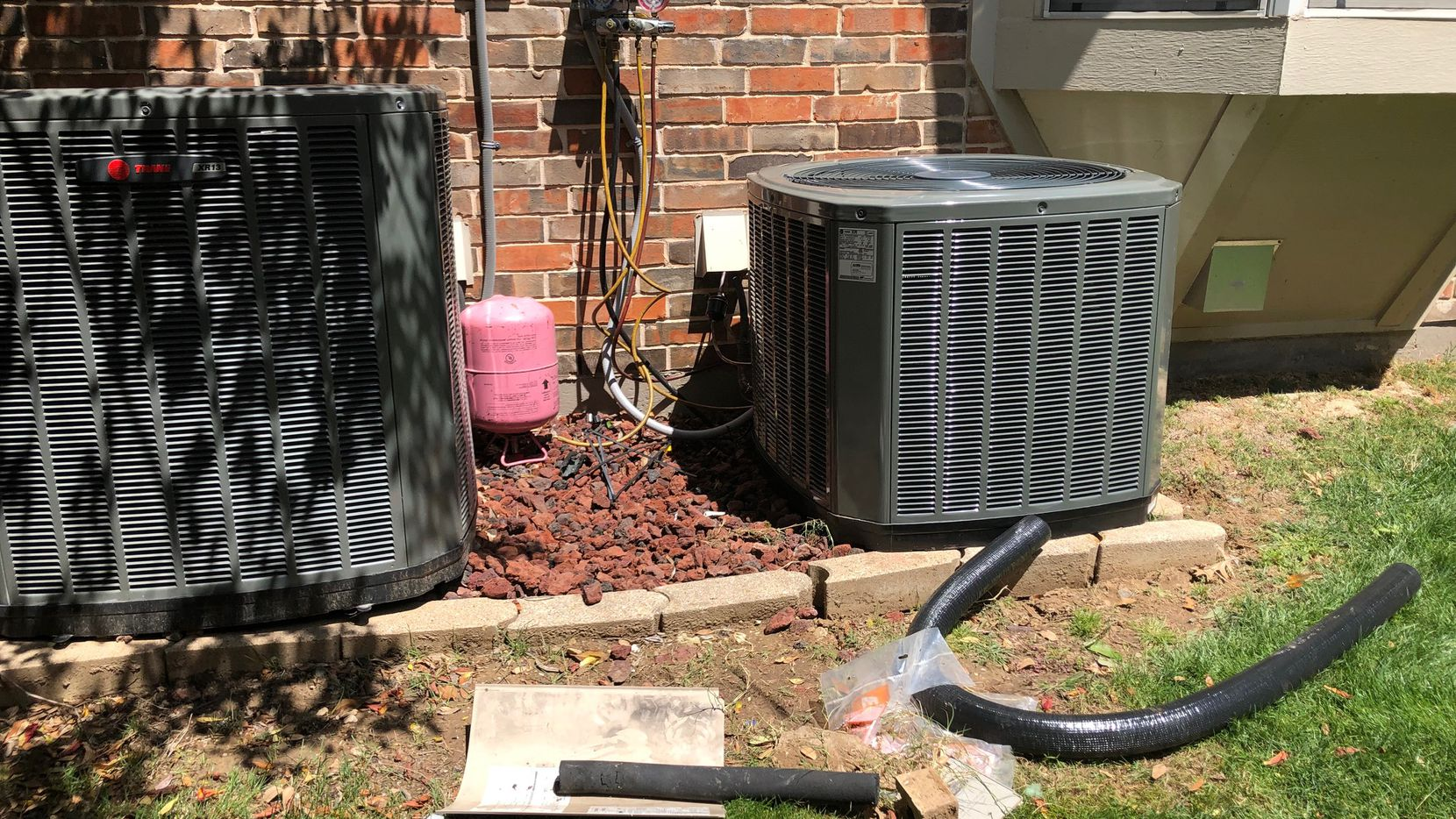 Watchdog Dave Lieber took this photo of the conversion of his home's air conditioning unit from the old refrigerant to the new, more environmentally friendly one. The manufacturing of Freon comes to a halt in January due to a federal mandate.