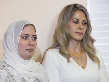 Fatima Altakrouri (left) and sister Muna Kowni listen to their attorney Marwa Elbially at a press conference by the Dallas-Fort-Worth chapter of the Council on American-Islamic Relations outlining a complaint they filed against Southwest Airlines for alleged religious discrimination on Tuesday, June 1, 2021, in Plano. (Juan Figueroa/The Dallas Morning News)