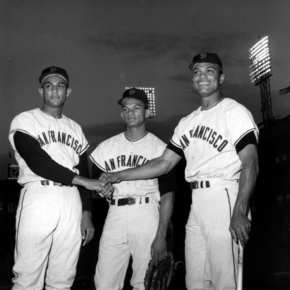 In this Sept. 10, 1963 file photo, San Francisco outfielders, from left, Jesus Alou, Matty Alou, and Felipe Alou, of the Dominican Republic, pose in a three-way hand shake before start of a baseball game with the New York Mets at New York's Polo Grounds. (AP Photo/File)