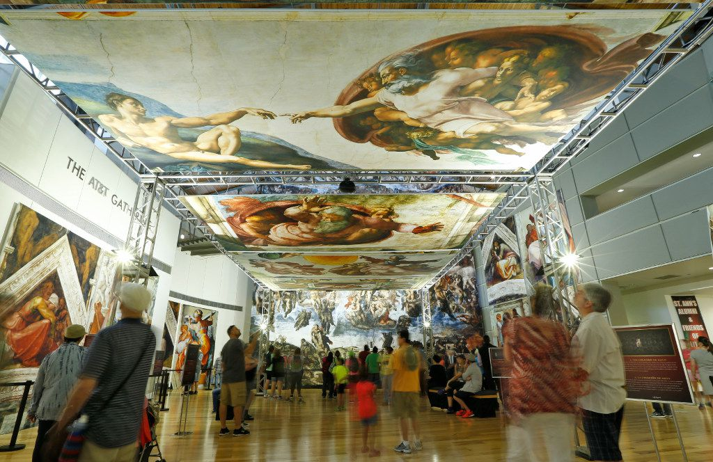 People look at the photo reproduction of the Sistine Chapel that includes 33 panels in an exhibit at the State Fair of Texas in Dallas.  (Nathan Hunsinger/The Dallas Morning News)