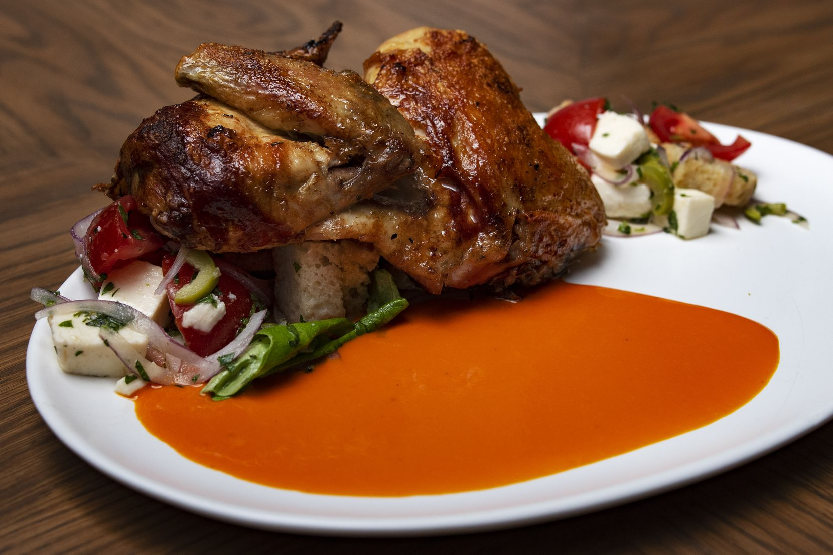 Chef Graham Dodds is making rotisserie chicken with panzanella salad and piquillo vinaigrette at Elm & Good restaurant.
