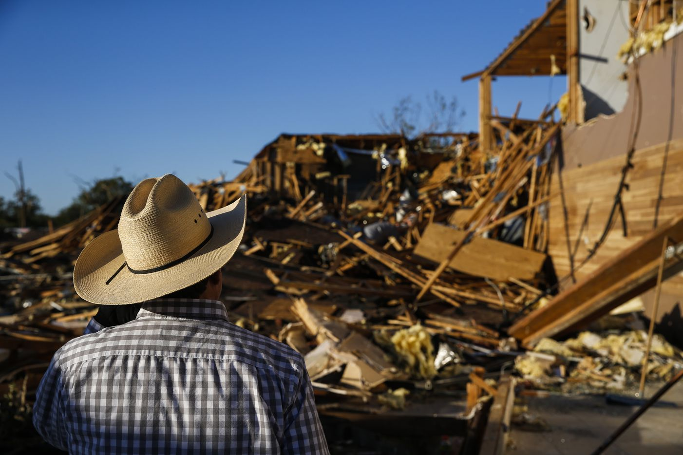 Hector Rodriguez, who has served as  deacon of Primera Iglesia Bautista Mexicana since 1987, surveys damage at the church just off of Walnut Hill Lane in Dallas, on Sunday, Oct. 21, 2019 after a tornado hit the night before.