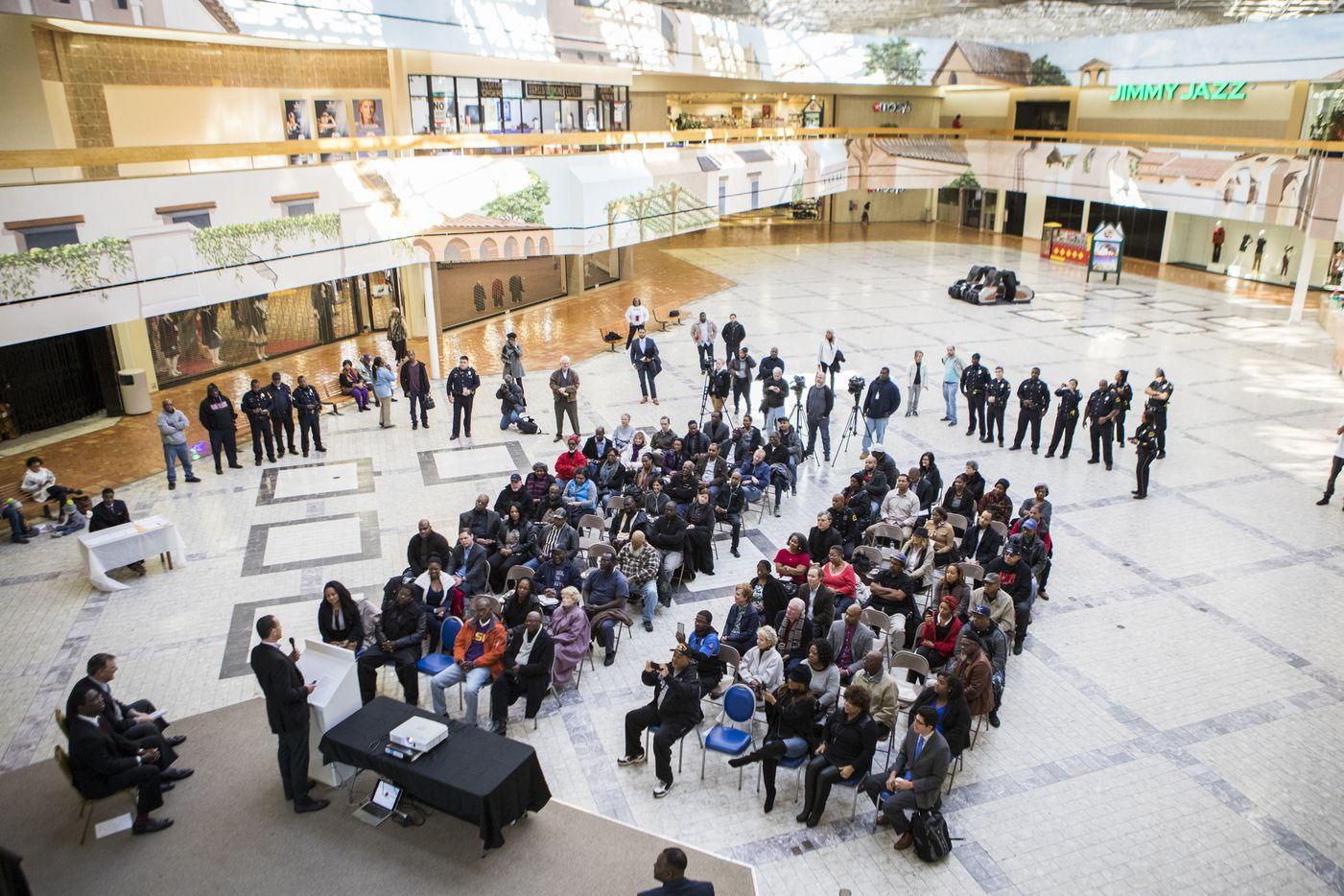 Community members gathered to see the future of the mall formally known as Red Bird Mall on Jan. 7, 2017, at Southwest Center Mall in Dallas. Developers plan to update the architecture of the mall while saving the atrium and arches outside of the closing Macy's department store.