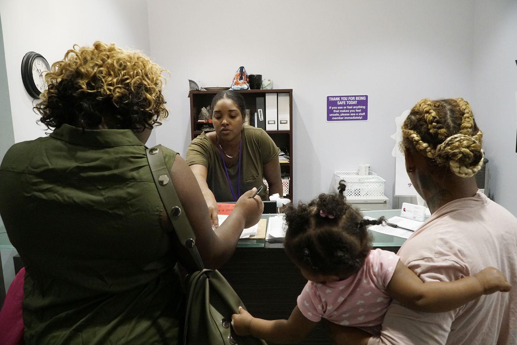 Resident Advocate Kari Webb (center) assists clients at the women's shelter at Family Place in Dallas, Texas on Tuesday, November 26, 2019. Uber just awarded the organization a $32K ride share and $8K cash grant.