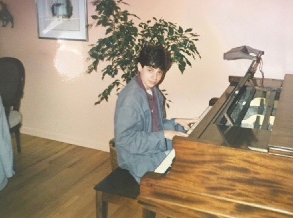 David Yaffe, playing the piano in the home of a family friend. Yaffe has written a new biography of Joni Mitchell.