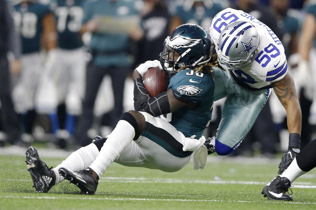 Dallas Cowboys middle linebacker Anthony Hitchens (59) tackles Philadelphia Eagles running back Jay Ajayi (36) during the first half of play at AT&T Stadium in Arlington, Texas on Sunday, November 19, 2017. (Vernon Bryant/The Dallas Morning News)