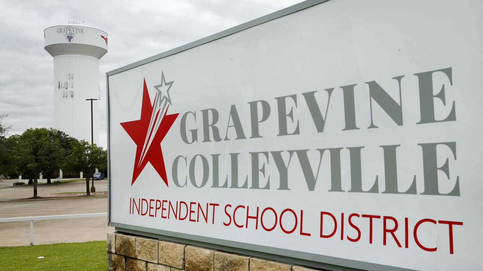 The Grapevine-Colleyville ISD sign is pictured before a Grapevine, Texas water tower, Tuesday, June 23, 2020.