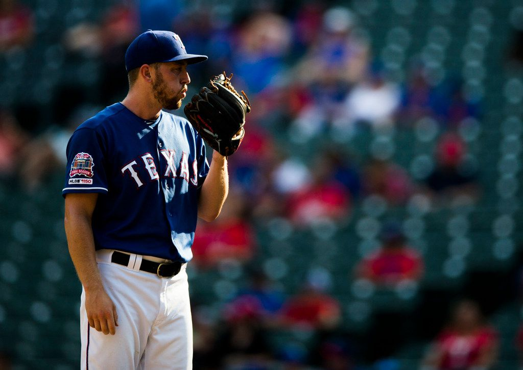 FILE - Rangers relief pitcher Adrian Sampson (52) is pictured during the ninth inning of a game against the Seattle Mariners on Sunday, Sept. 1, 2019, at Globe Life Park in Arlington.