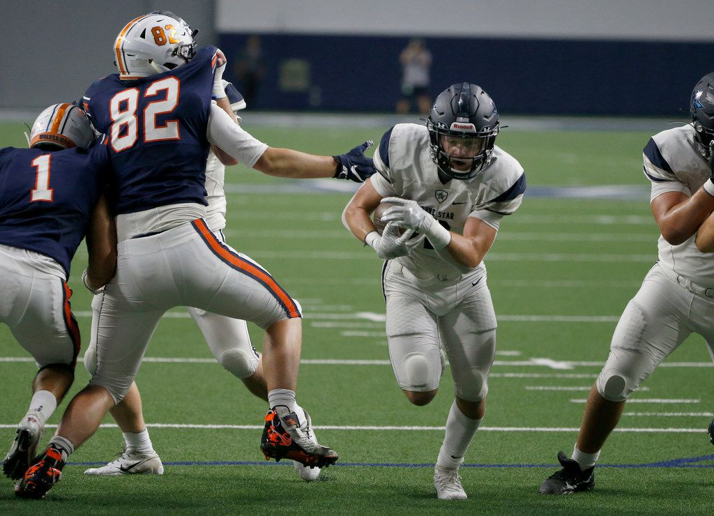 Frisco Lone Star's Jake Bogdon (2) scores a touchdown as Frisco Wakeland's Preston Snean (82) defends, during the first half of their high school football game in Frisco, Texas on January 1, 2019. (Michael Ainsworth/Special Contributor)