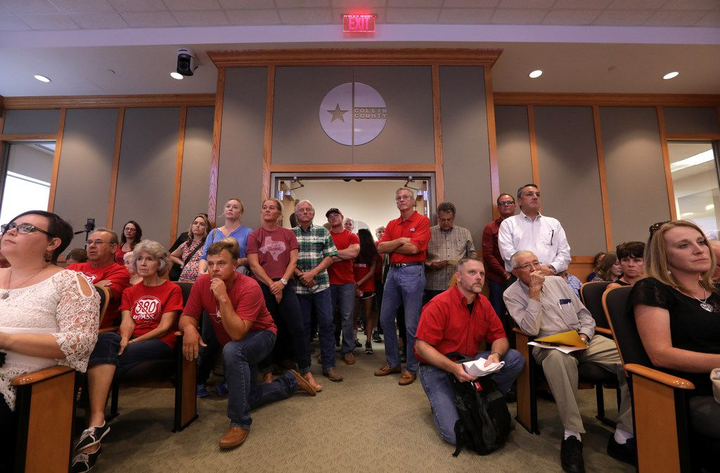 Local landowners crowd the room and hallway to oppose a possible annexation during a council meeting at the Jack Hatchell Collin County Administration Building in McKinney on Sep. 19, 2017.