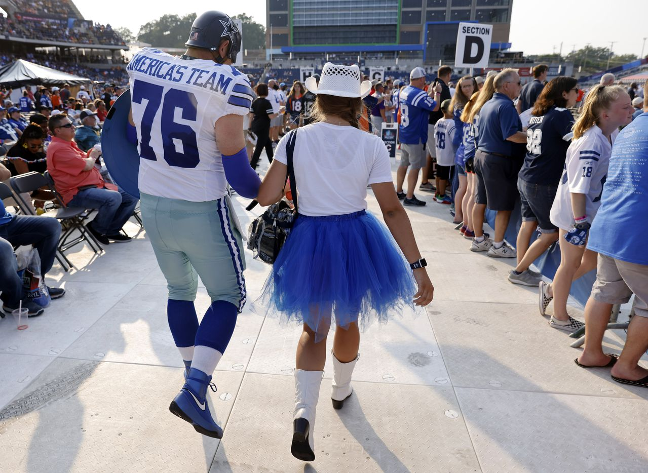Dallas Cowboys fans Eric Welborn of Elkin, North Carolina and his 15 yr-old daughter Sophie head to their seats in the Caption America's Team outfit during the Pro Football Hall of Fame Class of 2021 enshrinement ceremony at Tom Benson Hall of Fame Stadium in Canton, Ohio, Sunday, August 8, 2021. (Tom Fox/The Dallas Morning News)