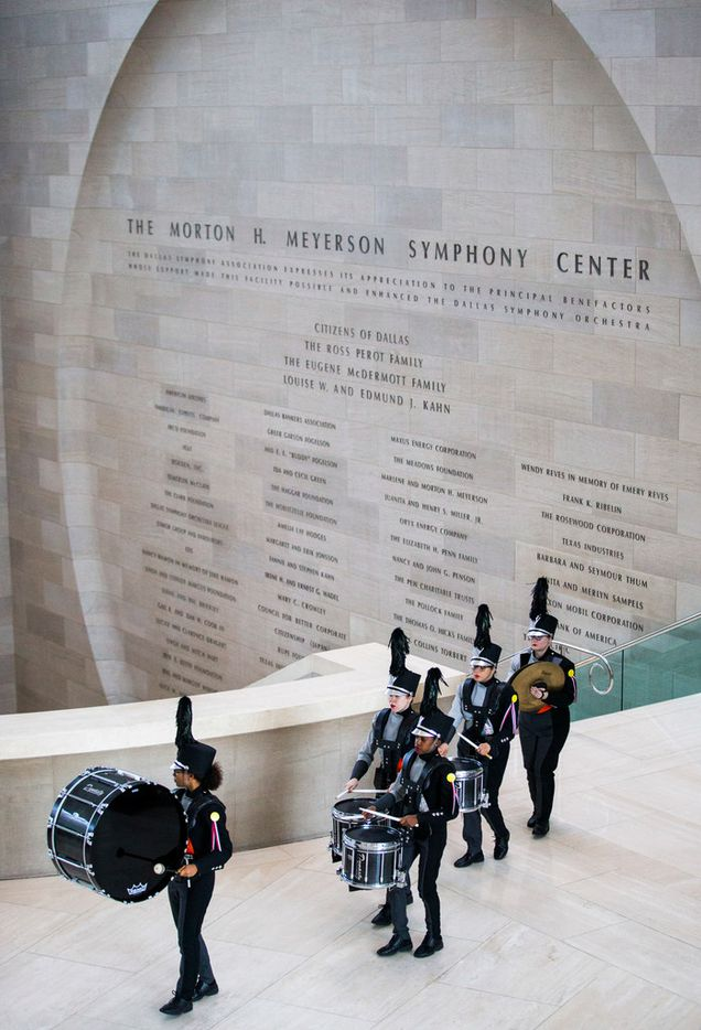"""The Haltom drumline performs during a pop-up performance entitled """"Eyes as Bright as Diamonds"""" to kick off the Soluna International Music & Arts Festival on Wednesday, April 11, 2018 at the Morton H. Meyerson Symphony Center in Dallas. The performance brings together New York artist Jen Ray, musician Sarah Jaffe and several Dallas performers. (Ashley Landis/The Dallas Morning News)"""