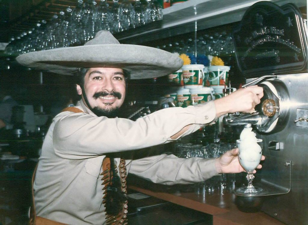 Mariano Martinez in 1991 with his frozen margarita machine at Mariano's in Old Town.