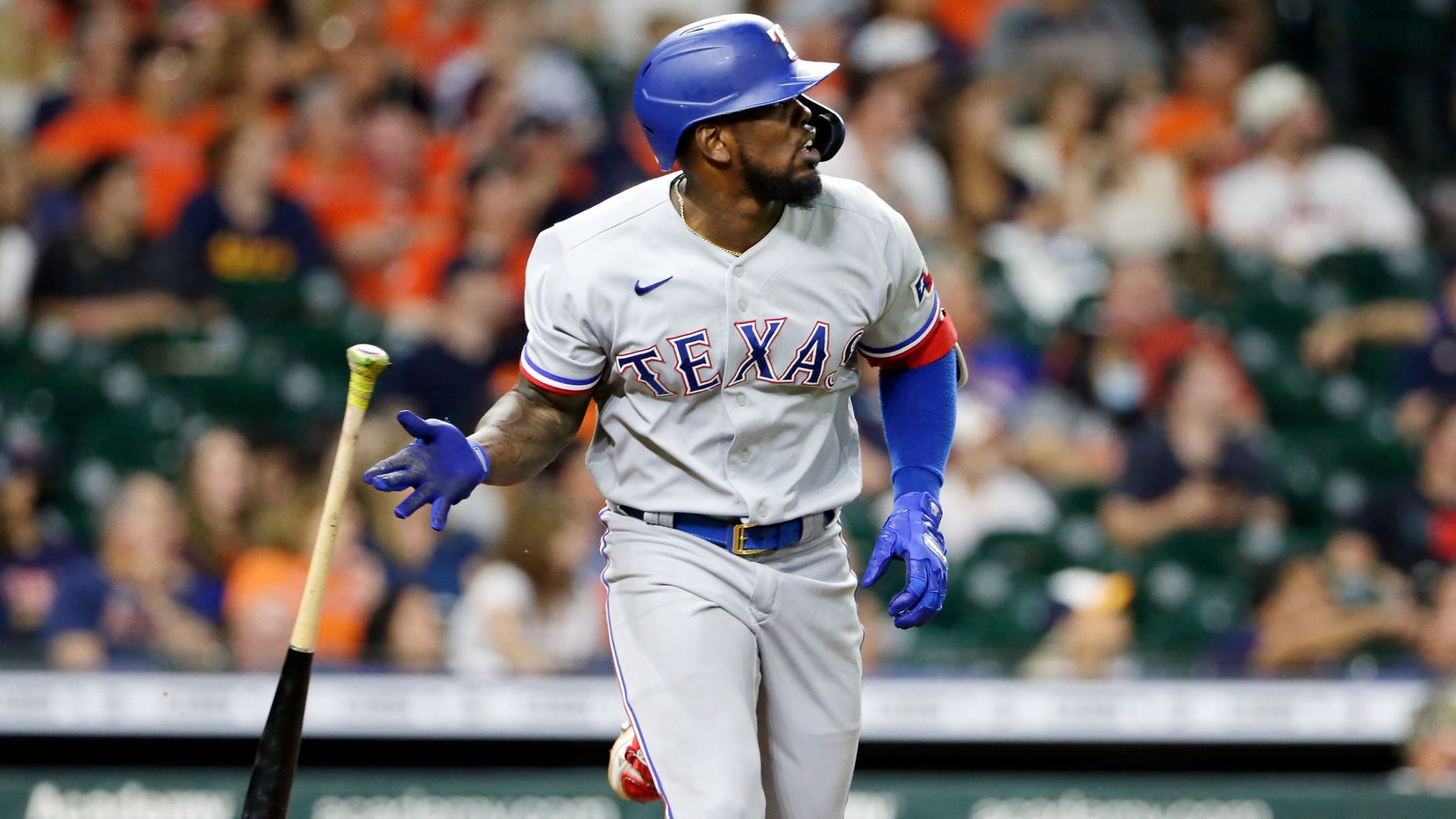 Texas Rangers' Adolis Garcia flips his bat as he watches his home run against the Houston Astros during the eighth inning of a baseball game Friday, May 14, 2021, in Houston.