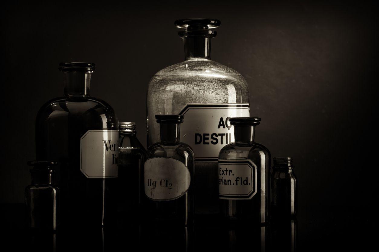 Arrangement of old pharmacy bottles.