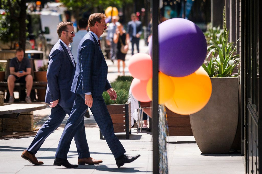 Lothar Estein (center) walks along Victory Park Lane after the ceremony marking the completion of the new retail street at Victory Park on Tuesday.