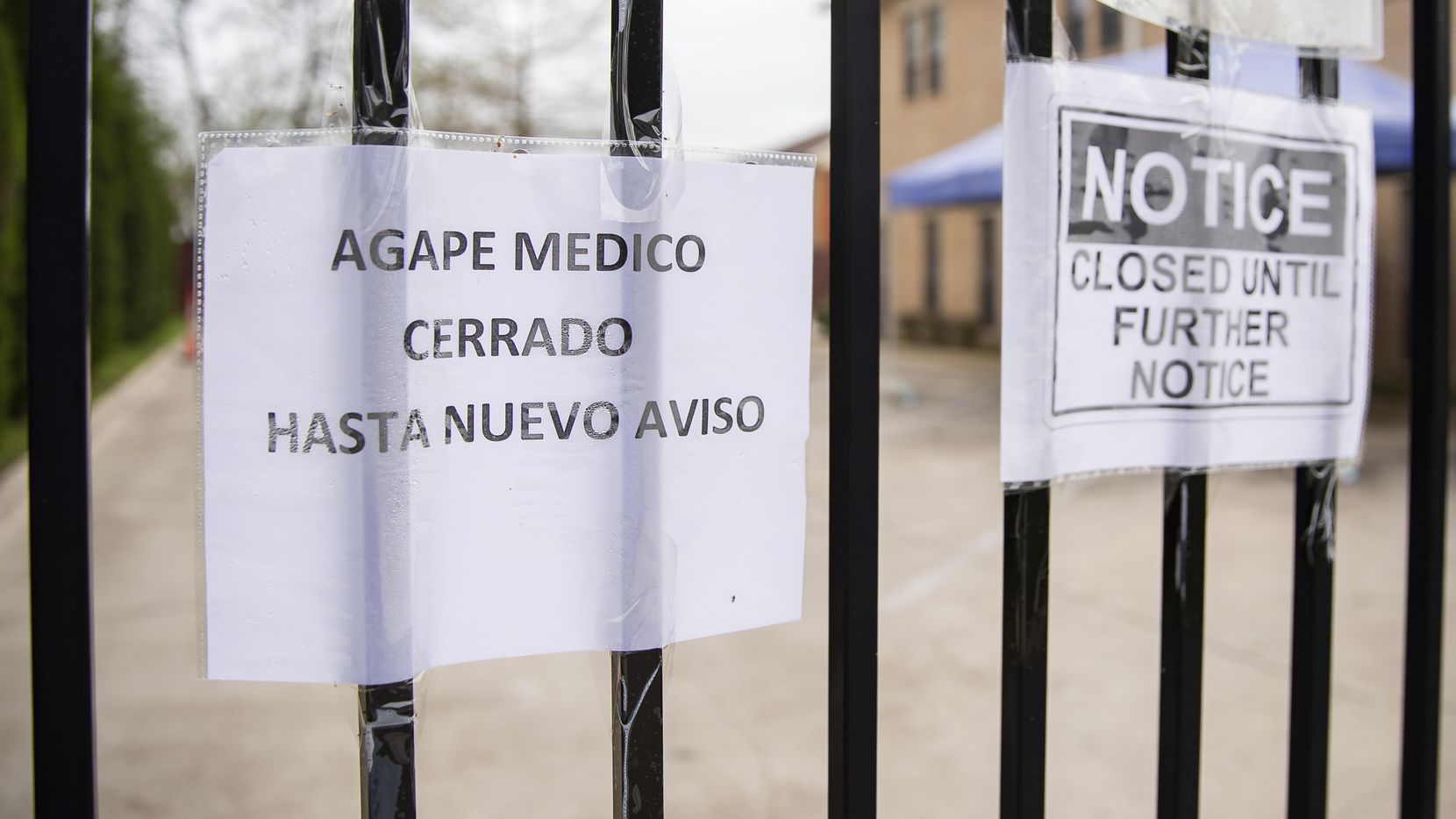 Signs in Spanish and English announce the closure of the Agape Clinic on March 16, 2020 in Dallas.