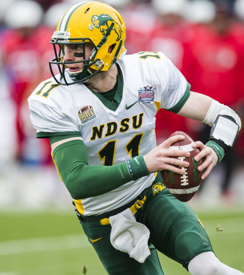 North Dakota State Bison quarterback Carson Wentz (11) runs the ball during the first half of the NCAA Division I Football Championship Game between North Dakota State and Illinois State on Saturday, January 10, 2015 at Toyota Stadium in Frisco, Texas.   (Ashley Landis/The Dallas Morning News)