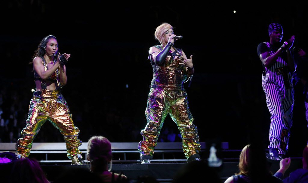 T-Boz (right) and Chilli (left) of TLC during a performance at American Airlines Center in Dallas, on Thursday, May 14, 2015.