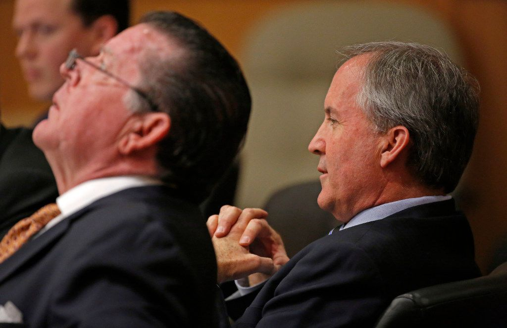 Texas Attorney General Ken Paxton (right) and his attorney Dan Cogdell sit at the defense table during his pretrial hearing at Collin County Courthouse in McKinney, Texas, Thursday, Feb. 16, 2017. (Jae S. Lee/The Dallas Morning News)