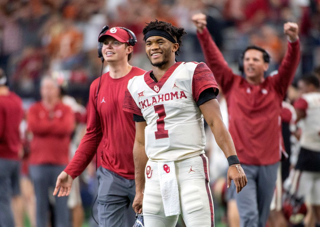 FILE - In this Dec. 1, 2018, file photo, Oklahoma quarterback Kyler Murray (1) celebrates on the sidelines after throwing a touchdown against Oklahoma during the second half of the Big 12 Conference championship NCAA college football game, in Arlington, Texas. Murray is The Associated Press college football Player of the Year. (AP Photo/Jeffrey McWhorter, File)