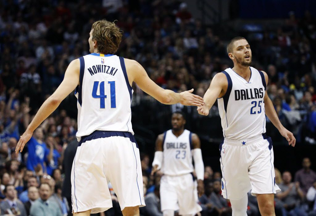 Dec 26, 2015; Dallas, TX, USA; Dallas Mavericks forward Dirk Nowitzki (41) and forward Chandler Parsons (25) celebrate during the first quarter against the Chicago Bulls at American Airlines Center. Mandatory Credit: Kevin Jairaj-USA TODAY Sports
