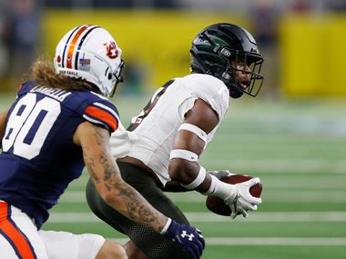 FILE - Oregon safety Jevon Holland (8) intercepts a pass intended for Auburn wide receiver Sal Cannella (80) during the second quarter of play at AT&T Stadium in Arlington on Friday, Aug. 31, 2019.