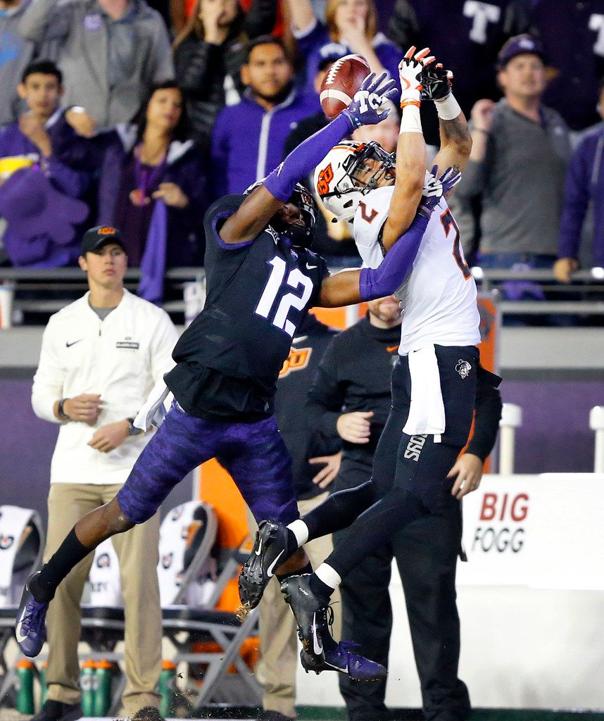 TCU Horned Frogs cornerback Jeff Gladney (12) keeps Oklahoma State Cowboys wide receiver Tylan Wallace (2) from catching a second half pass at Amon G. Carter Stadium in Fort Worth, Texas, Saturday, November 24, 2018. The Frogs hung onto win, 31-24. (Tom Fox/The Dallas Morning News)
