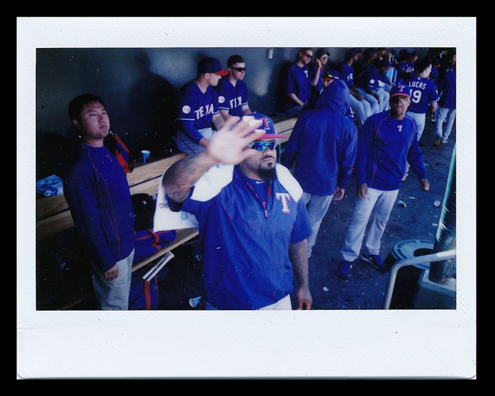 Texas Rangers spring training 2015: Texas Rangers first baseman Prince Fielder waits for the greeting of a teammate in the dugout during a spring training game against the Kansas City Royals at Surprise Stadium in Surprise, Arizona. (Andy Jacobsohn/The Dallas Morning News)